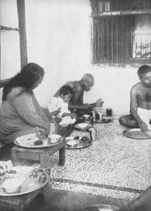 Paramhansa Yogananda with Mahatma Gandhi, eating a meal